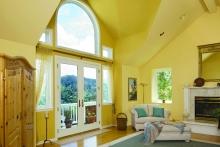 Patio doors, interior view, bright yellow living room
