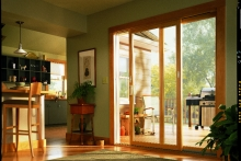Sliding patio doors, interior view of deck and barbecue