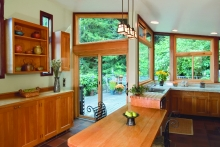 Modern sliding patio doors adjacent to kitchen and dining area