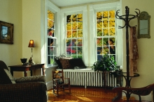 Double-hung windows, sitting room, view of surrounding trees